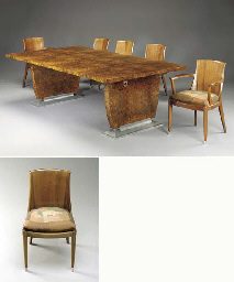 A WALNUT DINING TABLE AND SIX