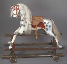 A carved wooden rocking horse