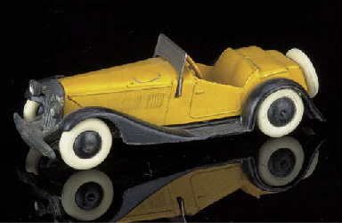A pre-war Dinky yellow and bla