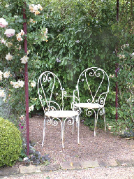 A PAIR OF ANTIQUE WROUGHT IRON