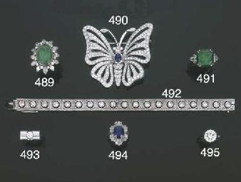 Anello in platino con smeraldo