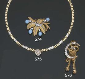 Spilla in oro con turchesi e d