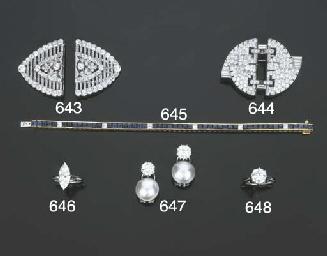Coppia di clip in platino e or