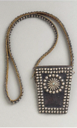 A NAVAJO SILVER AND LEATHER PO