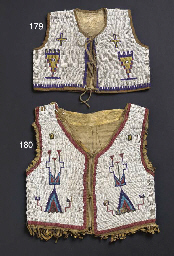 A SIOUX CHILD'S BEADED HIDE VE