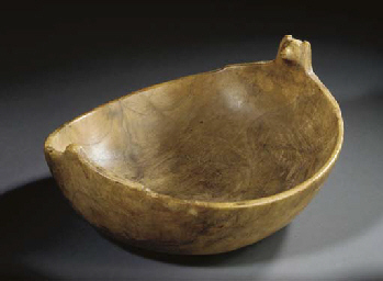 A SIOUX WOOD EFFIGY FEAST BOWL