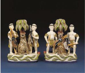 A pair of Zulu candlesticks