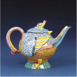 A chicken tea pot and cover