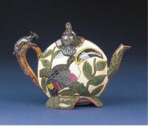 A toucan tea pot and cover