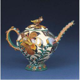 An owl tea pot and cover