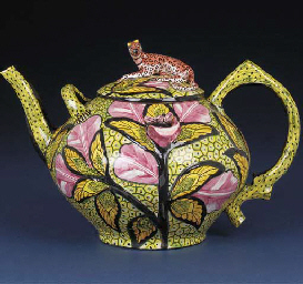 A leopard tea pot and cover