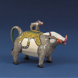 A warthog tea pot and cover