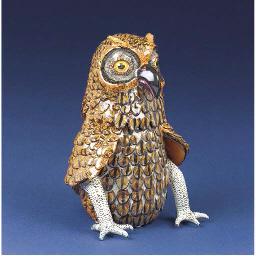 An owl cigar box holder