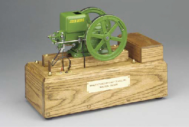 An enclosed crank hopper coole