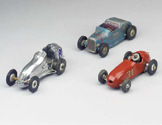 Three small commercial cars,