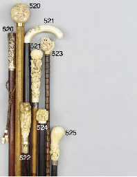 A Japanese ivory and silver mo