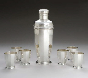 A SILVER COCKTAIL SHAKER AND S