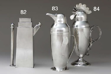 A SILVER-PLATED PENGUIN-FORM C