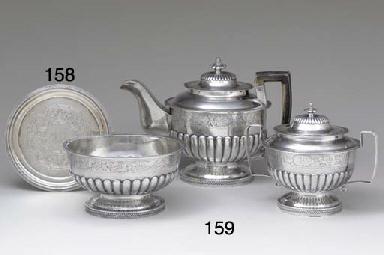 A SILVER THREE-PIECE TEA SERVI