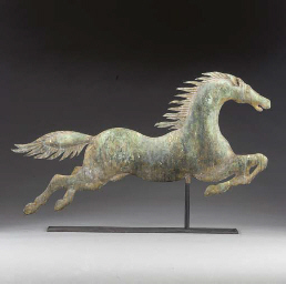 A MOLDED COPPER LEAPING HORSE