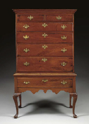 A CHIPPENDALE WALNUT CHEST-ON-