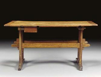 A BEECHWOOD TRESTLE TABLE