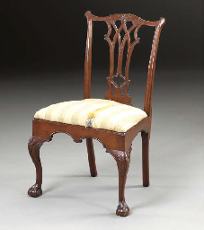A CARVED MAHOGANY CHIPPENDALE