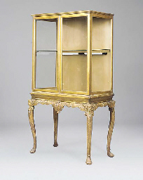 A gilt cabinet on stand