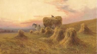Gathering hay at dusk