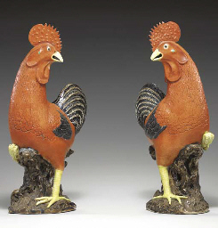 A PAIR OF IRON-RED ROOSTERS