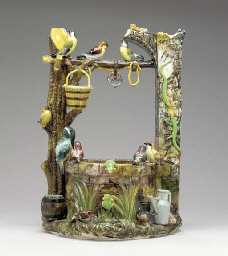 A FRENCH MAJOLICA MODEL OF A W