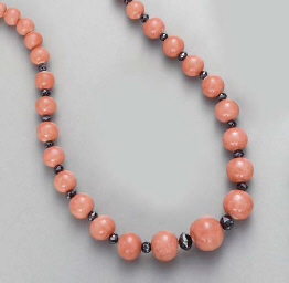 ** A CORAL AND BLACK DIAMOND N