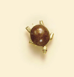 A BROWN ENAMEL, RUBY AND 18K G
