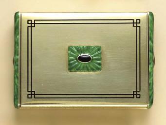 AN ART DECO GREEN AND BLACK EN