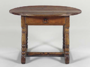 AN ENGLISH OAK CENTER TABLE