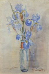 Blue irisses in a glass vase