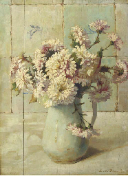Chrysanthemums in a jug by a t