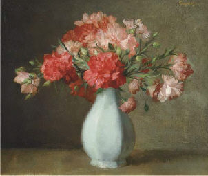Pink carnations in a white vas