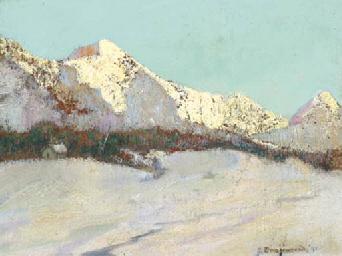 A snowy mountainrange at sunri