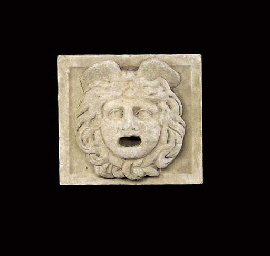 A RELIEF CARVED MARBLE ROMAN A