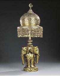 A CEYLONESE BRASS TABLE LAMP