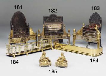 A pair of gilt brass chenet
