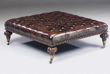 A LARGE OAK AND BROWN LEATHER