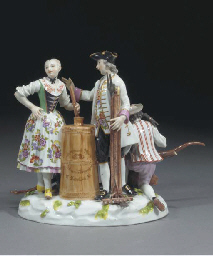 A Meissen group of three figur