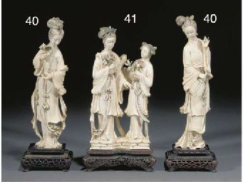 A Chinese ivory group of two m