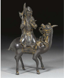 A Chinese bronze figure of sho