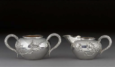A Chinese silver jug and sugar