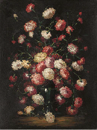 Carnations in a glass vase; an