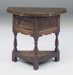 AN ENGLISH OAK FOLDING TABLE