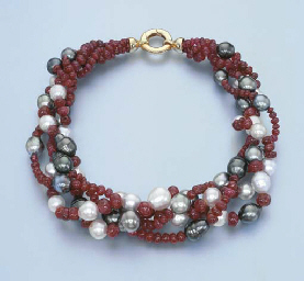 A RUBY BEAD AND CULTURED PEARL
